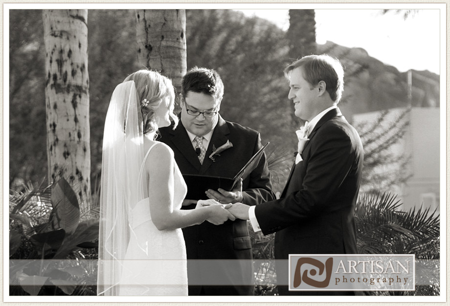 Camelback Inn Wedding Image of bride and groom exchanging the rings during ceremony
