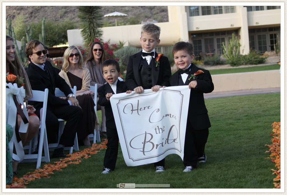 Camelback Inn Wedding Image of ring bearers with here comes the bride sign
