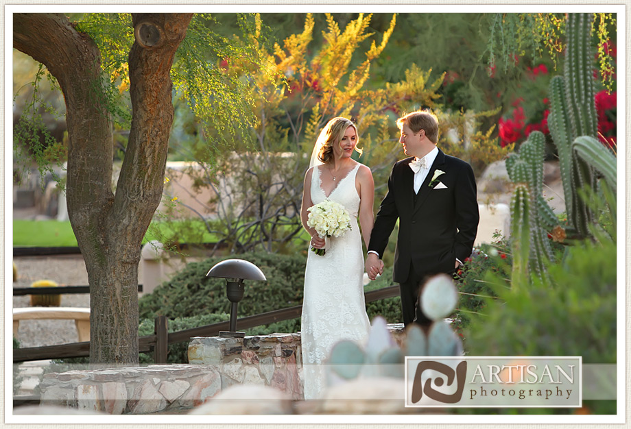 Camelback Inn Arizona Wedding Image of bride and groom candid shots kissing with cactus in the background