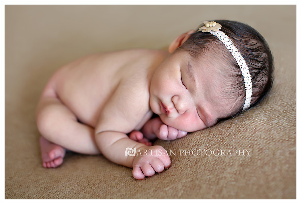 newborn baby girl picture with beige flower band