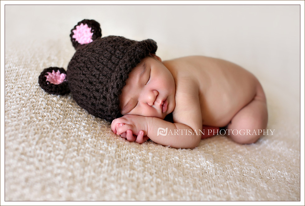 newborn baby girl picture with cute pink and brown bear hat