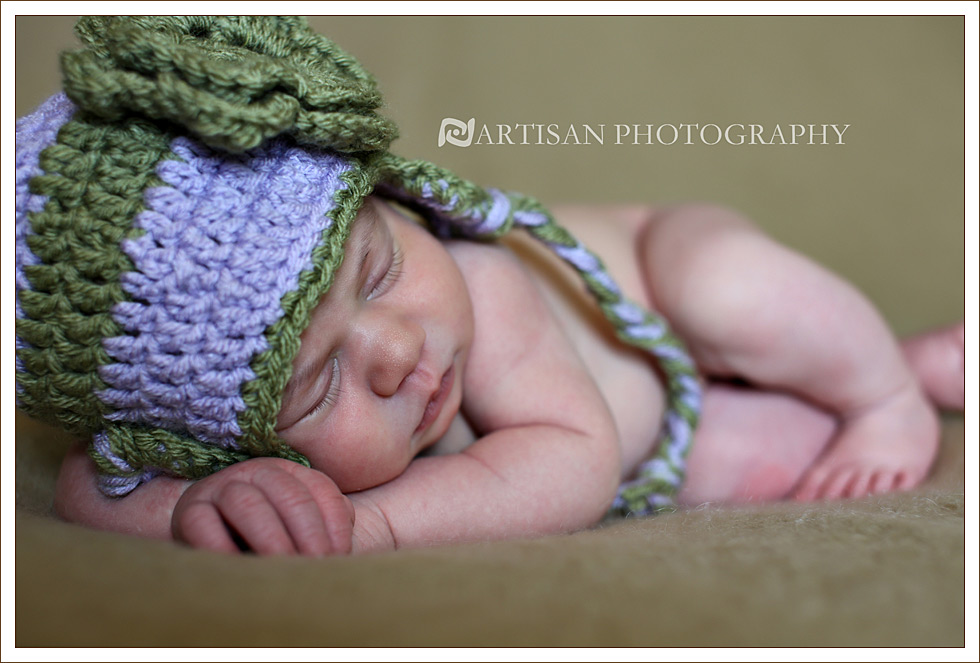 Newborn baby girl with lavender and green aviator flower hat