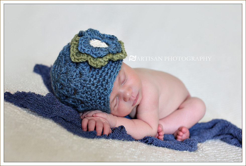 Newborn baby girl with blue flower hat