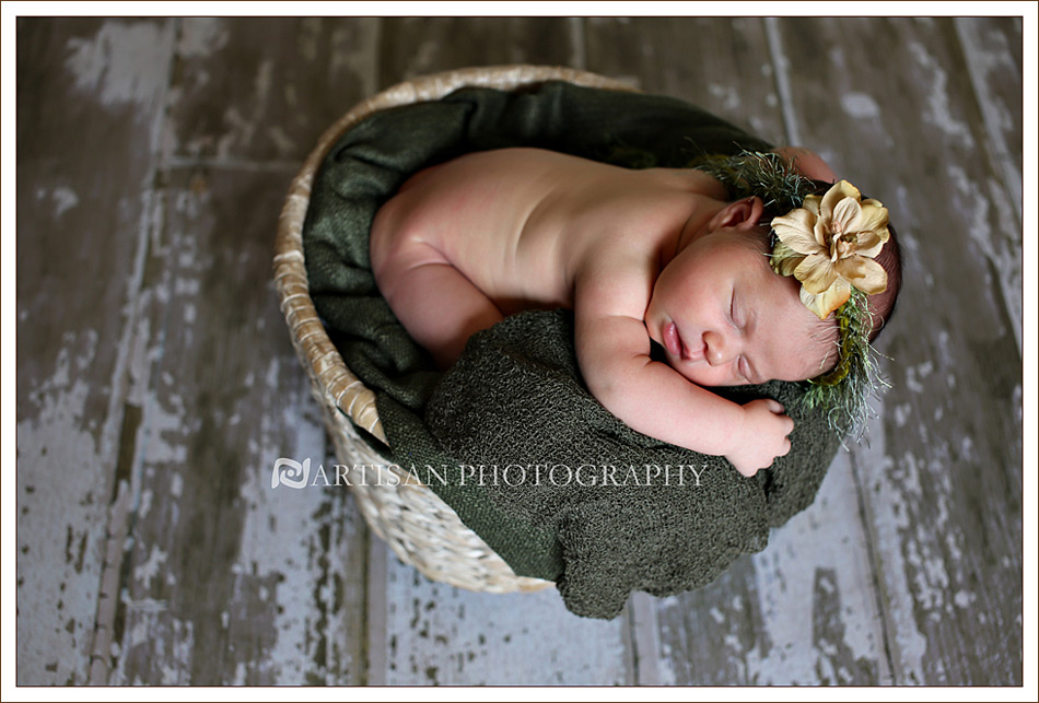 Newborn baby girl with with organic green flower band