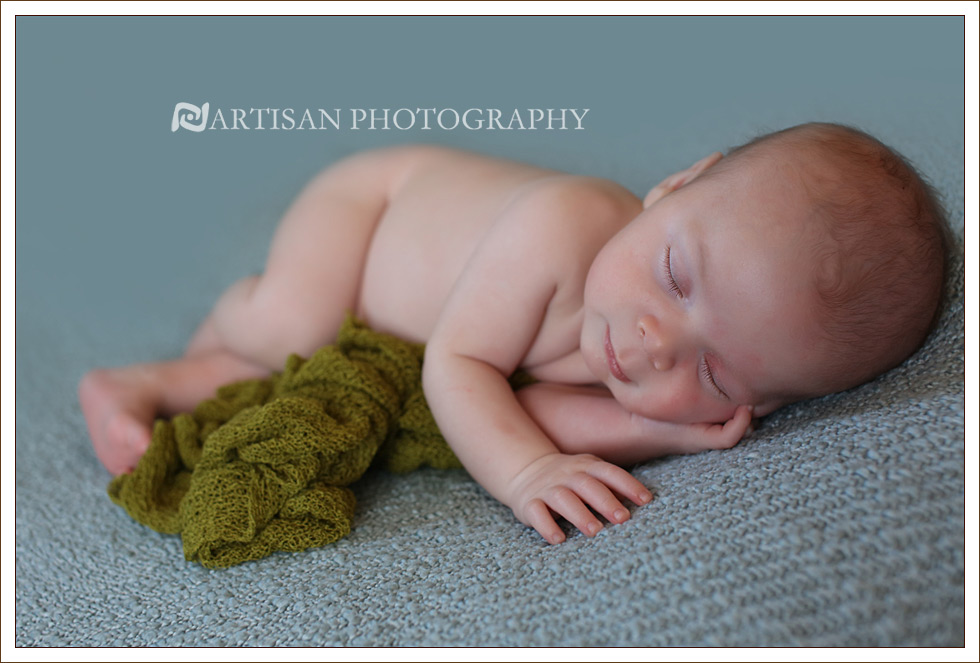 Newborn baby picture on light blue blanket