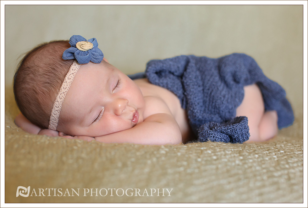 picture of baby girl with blue flower headband