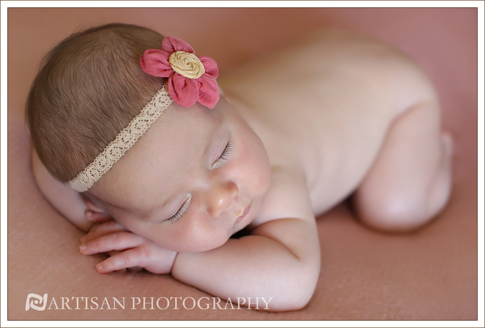 picture of baby girl in pink flower headband