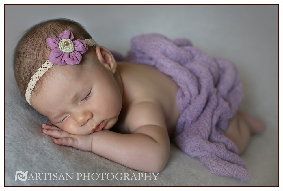 picture of baby girl with lilac headband