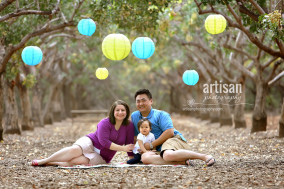 family photos at a Chandler park with lanterns hanging