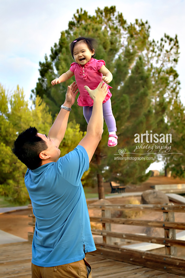 father and young daugther at the Gilbert park playing