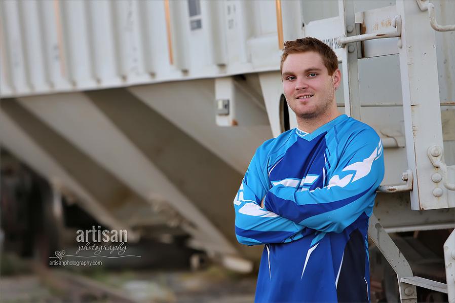 High school senior boy photo in front of train