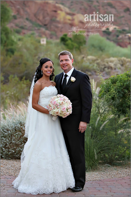 bride and groom on wedding day at Sanctuary Camelback Mountain resort holding beautiful flower bouquet