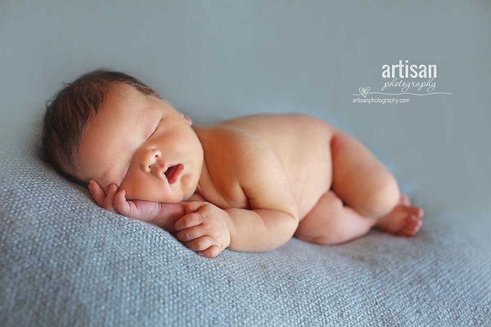 newborn baby boy photo laying on a blue blanket in Carlsbad California